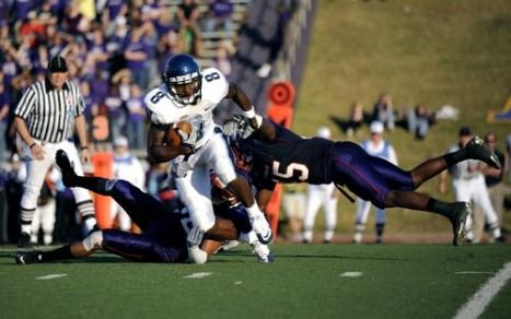 Staff photo by Andrew Rogers Villanova wide receiver Norman White tries to get past Stephen F. Austin State University defenders during a playoff game at Homer Bryce Stadium in Nacogdoches, Texas. (Staff photo by Andrew Rogers)