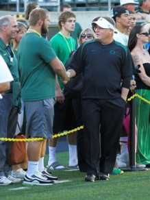 OL Doug Brenner (NR/Portland, OR) speaks with Chip Kelly.