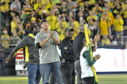 (L-R): LeGarrette Blount, Brandon Bair, Reggie Ogburn, Pat McNally are cheered by the Autzen celebrated as honorary captains for the game Saturday night.