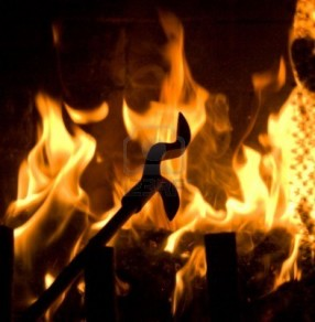 5583771-fireplace-poker-silhouette-in-flames-of-fire-background