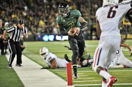 Bennett scrambles towards the end zone against Arizona