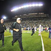 Head Coach, Chip Kelly, runs off the field after a victory against Arizona