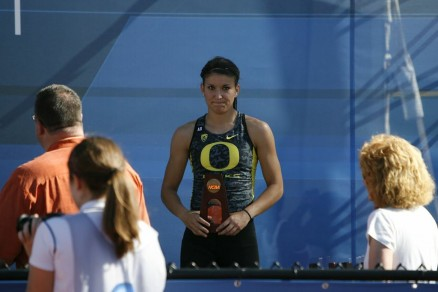 Jenna Prandinni receiving a trophy at the NCAA Championships