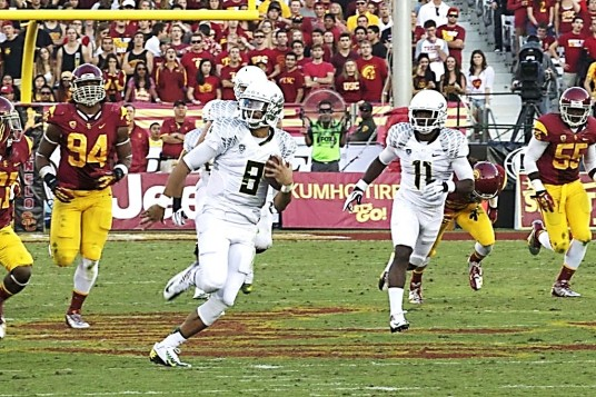 Figure 2. Marcus Mariota (8) runs for a gain in the 2012 USC game. Bralon Addison (11) is alongside to block. I am confident that Duck players are kept as healthy and strong as possible.