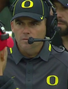 Coach focused upon a play call vs. UCLA