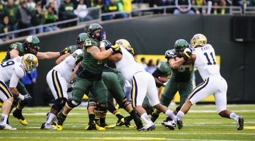 Ducks offensive line taking on UCLA. Oct. 26th 2013.