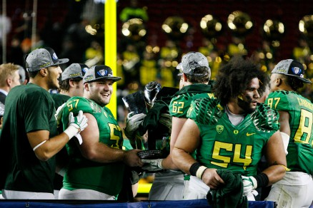 Brenner and teammates celebrate following the Pac-12 Championship victory.