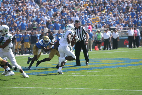 Royce Freeman runs the ball against UCLA