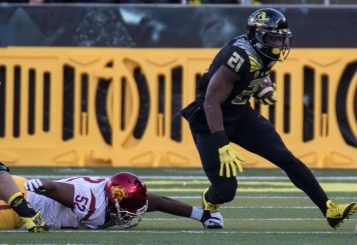 Royce Freeman and the Ducks flattened the Trojans, who nonetheless will play for the Pac-12 title.