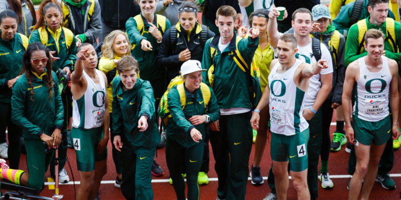 "Oregon track and field teammates yell ""Go Ducks"" with the crowd at the end of the meet. The Oregon Ducks hosts the annual Pepsi Invitational at Hayward Field in Eugene, Ore. on Saturday, April 11, 2015. (Taylor Wilder/Emerald)"